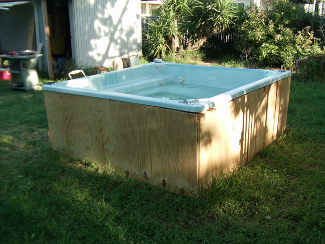 Diy hot tub koi pond for Koi pond tubs